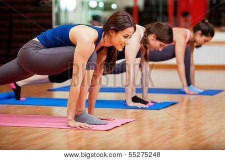 Cute young women doing yoga poster