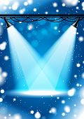 Bright spot lights with blue christmas background