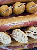 Bunch of freshly made sandwiches with French baguette