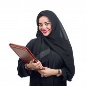 Beautiful Arabian woman holding a folder isolated on white