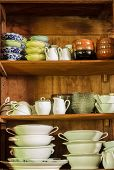 image of crockery  - Wooden crockery in the pantry in the kitchen - JPG