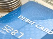 image of debit card  - Narrow focus of debit card with money - JPG