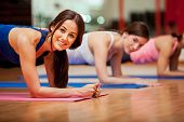picture of outfits  - Happy female friends exercising and having fun in a gym class - JPG