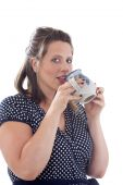 Woman Drinking Beverage From A Mug; Isolated