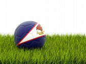 stock photo of samoa  - Football with flag of american samoa on green grass - JPG