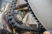 stock photo of dynamo  - old chain with grease on propel roller for motor powered - JPG