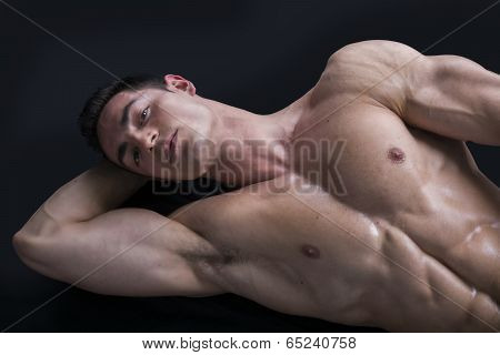 Attractive Young Man On The Floor With Muscular Ripped Body poster