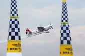PUTRAJAYA, MALAYSIA - MAY 17, 2014: Paul Bonhomme of Great Britain, in an Edge 540 V2 plane flies pa