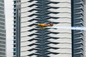 PUTRAJAYA, MALAYSIA - MAY 17, 2014: Matt Hall from Australia in a MXS-R plane flies through the race course over Putrajaya lake at the Red Bull Air Race World Championship 2014.