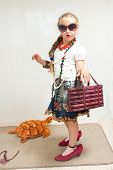 stock photo of little girls photo-models  - The photo shows a little girl she tries to imitate adults and look fashionable and stylish - JPG