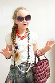 picture of little girls photo-models  - The photo shows a little girl she tries to imitate adults and look fashionable and stylish - JPG