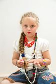 image of little girls photo-models  - The photo shows a little girl she tries to imitate adults and look fashionable and stylish - JPG