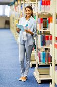 portrait of female university student in library