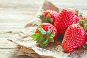 fresh strawberries closeup on wooden background
