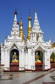 stock photo of yangon  - Stupas with buddha statues in Shwedagon Pagoda Yangon Myanmar - JPG