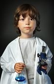 child with retort and microscope