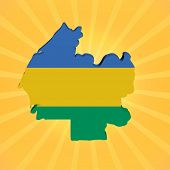 Gabon map flag on sunburst illustration