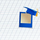 Mortar Board Or Graduation Cap With Blue Slide On The Background Notebook Sheet