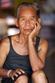 BAM MUANG PAM, THAILAND, NOVEMBER 22 : close portrait of an old Karen tribe man, Thai ethnicity, in