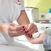 Blood type testing by prick test.