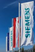 Vienna, Austria - March 30, 2014:  Flags Bearing The Siemens Logo In Front Of Their Austrian Company