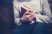 Nervous Young Man Clutching Book