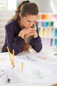Portrait Of Concerned Fashion Designer In Office