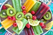 image of popsicle  - Colorful popsicles with fresh fruits in vintage tray - JPG