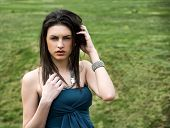 Attractive Young Woman In Green Grassland