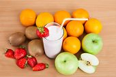 Close-up Of Strawberry Milkshake And Fruits