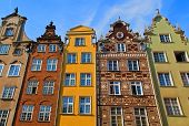 stock photo of tenement  - Colorful tenement houses on the blue sky background