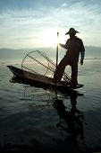 Silhouette Of Traditional Fishermans In Inle Lake,myanmar.