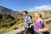 Hiker couple hiking on Gran Canaria. Romantic hikers enjoying hike in beautiful mountain forest land