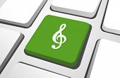 Close-up of green treble clef on a keyboard button.