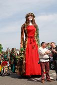 HASTINGS, ENGLAND - MAY 5, 2014: Flora the Singleton Giant is paraded on the West Hill during the an