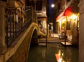 Narrow canal in Venice at night, Italy.  Ponte dei Ferai