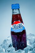 MOSCOW, RUSSIA-APRIL 4, 2014: Bottle of Pepsi cola on ice. Pepsi is a carbonated soft drink that is