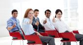 Business People With Thumbs Up At A Conference