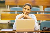 portrait of cute indian college student in lecture room