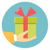 picture of courtesy  - Isolated round flat icon of a hand holding a green gift box decorated with a red bow  on blue - JPG