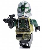 Ankara, Turkey - April 28, 2014: Lego Star Wars AT-AP minifigure Clone Commander Gree isolated on white background.