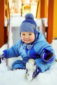 Joyful Kid On Children Playground In Winter