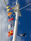 picture of wispy  - Nautical Flags Flying from a Ship - JPG