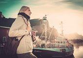 Woman traveler in Reine village, Norway