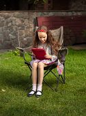 Brunette Girl Using Tablet At Yard