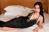 stock photo of negligee  - Pretty young brunette in a black negligee - JPG