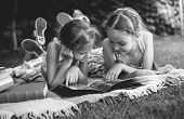Monochrome Photo Of Young Girls Looking At Family Photo Album