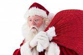 Santa takes care about his sack on white background