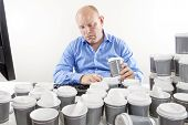 Overworked businessman drinking too much coffee
