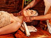 pic of ayurveda  - Woman having facial  ayurveda spa treatment - JPG